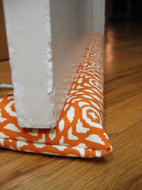 20 DIY Door Draft Stoppers That Keep Your Home Insulated | thegoodstuff & 20 DIY Draft Stoppers That Keep Your Home Insulated - thegoodstuff