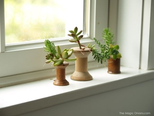 16. antique wooden spool planters