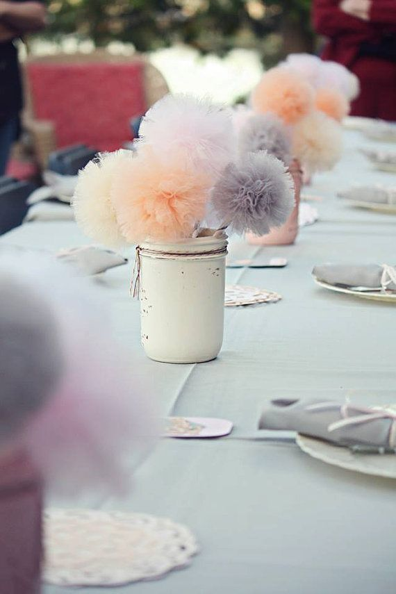 22 eye catching inexpensive diy wedding centerpieces thegoodstuff tulle pompom centerpieces thegoodstuff junglespirit Choice Image
