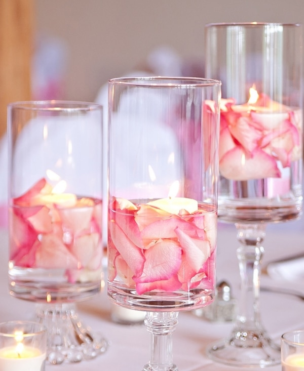 22 eye catching inexpensive diy wedding centerpieces thegoodstuff 22 eye catching inexpensive diy wedding centerpieces floating flower hurricanes centerpiece idea junglespirit Image collections