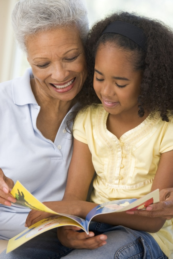 Granddaughter and grandmother reading together | thegoodstuff