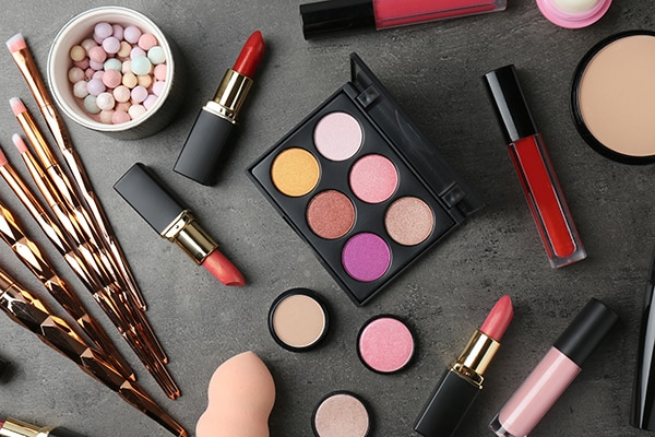 free beauty product samples spread out on a table